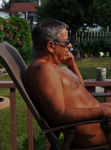 Taking it easy with a morning coffee on my back deck listening to birds and enjoying a small town's summer.